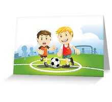 Two boys play soccer on a field Greeting Card