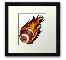 Realistic American football in the fire Framed Print