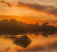 Sunset over Tranquil River and Bank by Alius Imago