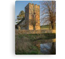 Village church in evening sunshine Canvas Print