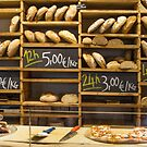 Modern bakery with different kinds of bread by Bruno Beach