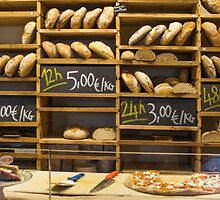 Modern bakery with different kinds of bread by Atanas NASKO