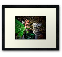 Glimpse of a woodland fairy by the stream Framed Print