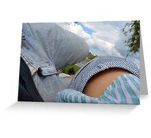 Couple lying on a blanket in the park at a picnic. Greeting Card