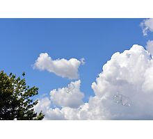 Blue sky with fluffy clouds and soap bubbles. Photographic Print
