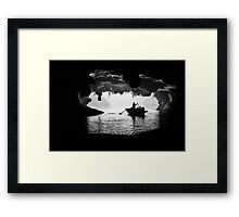 Rowing into the Cave Framed Print