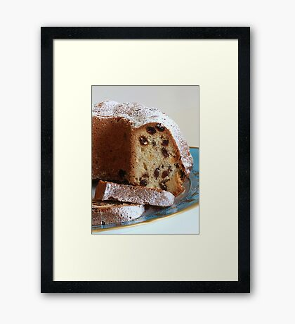 Cupcake with raisins close to Framed Print