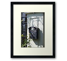 Old mailbox with newspaper Framed Print