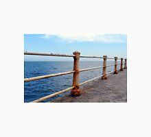 The sea and promenade with rusty white handrail. Unisex T-Shirt