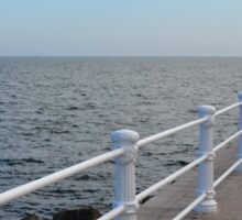 The sea and promenade with  white handrail. Sticker