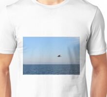 Seagull in flight and the blue sea and calm sky. Unisex T-Shirt
