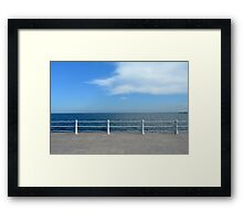 The sea and promenade with  white handrail. Framed Print