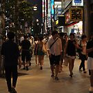Walking in Tokyo at night by Christian Eccleston