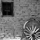 Adobe and Wagon Wheel by Larry Costales