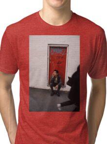 Caught. Tri-blend T-Shirt