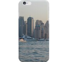 15 March 2016. Photography of skyscrapers skyline from Dubai seen from the water with boats, United Arab Emirates. iPhone Case/Skin