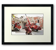 L'Aquila: collapsed building with firefighters at work Framed Print