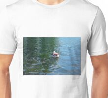 Swan in the water in the park. Unisex T-Shirt