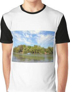 Park scenery with dramatic sky and trees by the river. Graphic T-Shirt