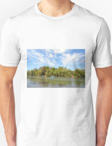 Park scenery with dramatic sky and trees by the river. Unisex T-Shirt