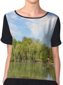 Park scenery with dramatic sky and trees by the river. Chiffon Top