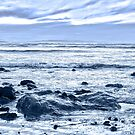 blue toned rocky beal beach by morrbyte