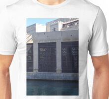 Building by the water with metal protection. Unisex T-Shirt