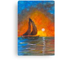 A boat sailing against a vivid colorful sunset  Canvas Print