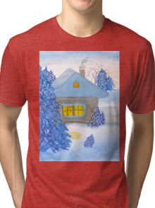 A small cottage in the fairy forest in snow. Tri-blend T-Shirt
