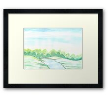 River flowing through meadows Framed Print