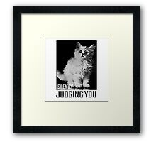 Kitty is silently judging you Framed Print