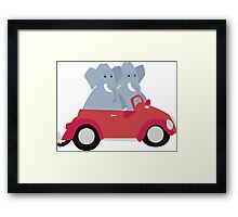 Funny elephants in red beetle car Framed Print