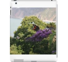 Red admiral on rose bay willow herb, backdrop of Exmoor coastline. iPad Case/Skin