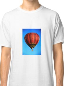 Red hot air balloon in flght on blue sky. Classic T-Shirt
