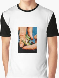 Green bush frog hanging onto finger Graphic T-Shirt