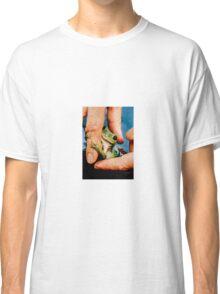Green bush frog hanging onto finger Classic T-Shirt