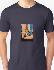 Green bush frog hanging onto finger Unisex T-Shirt