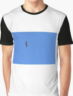 Seagull flying in the blue sky. Graphic T-Shirt