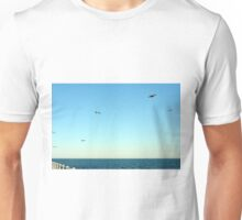 Seagulls flying above the sea. Unisex T-Shirt