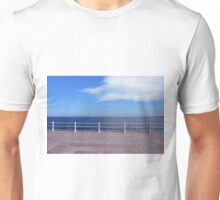 Promenade by the sea with cloudy sky and white handrail. Unisex T-Shirt