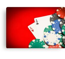 Pair of aces and chips on a red table Canvas Print