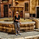 A girl by the fountain. by naranzaria