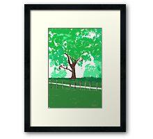 tree behind fence Framed Print