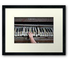 Creepy Piano Baby Framed Print