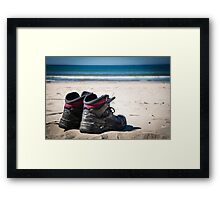 Used trekking shoes in the sand Framed Print