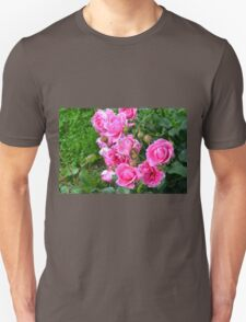 Pink roses in the garden. natural background. Unisex T-Shirt