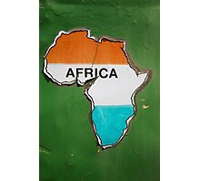 Old African shape sticker on green crumbling wall  Photographic Print