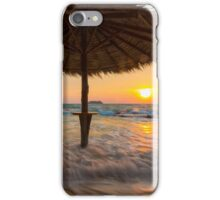 Empty beach with straw umbrella on sunrise iPhone Case/Skin