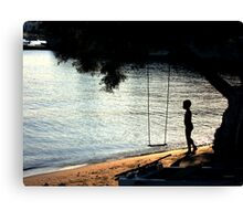 The Swing and the boy Canvas Print