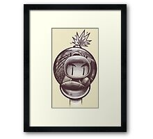 HAND WITH REFLECTING BOMB Framed Print